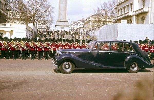 Queen Elizabeth II travelling to the State Opening of Parliament in her limousine. London, England. Date: 1966