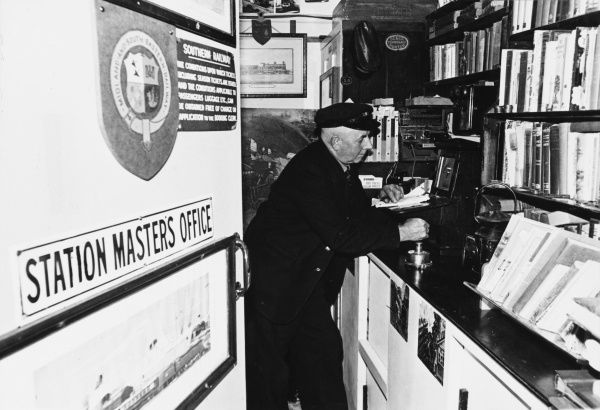 The Station Master in his office at Warden Central with the coat of arms for Midland and South Eastern Railway on the door Date: 1960s