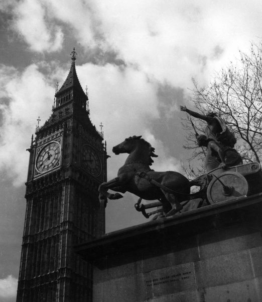 Bronze statue of Boadicea (Boudicca), Queen of the Iceni, at the foot of Westminster Bridge, London, was sculpted in 1850 by Thomas Thornycroft. Seen here with Big Ben towering above it