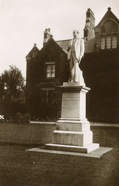 Statue of Thomas Hughes (1822-1896), the Author of 'Tom Brown's Schooldays' (1857) which stands outside the Rugby School Library. The statue was created by sculptor Thomas Brock and unveiled in 1899. Date: circa 1920s