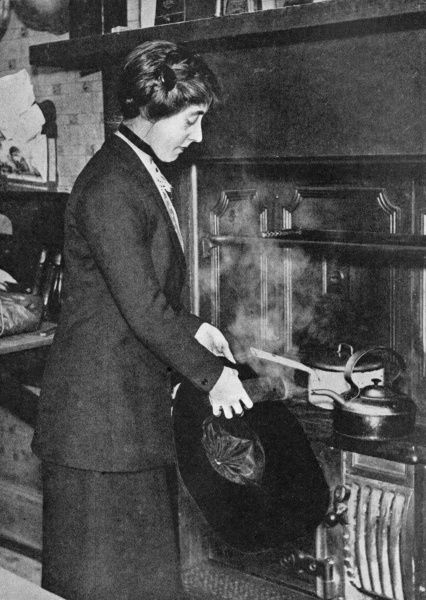 Photograph demonstrating how to steam a hat in order to freshen shabby headwear