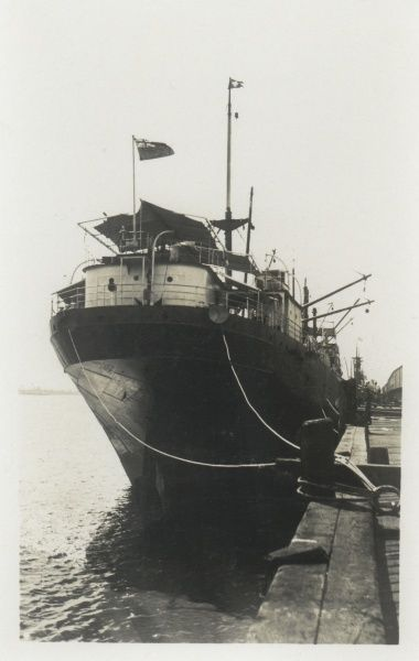 A steamship moored in a dock