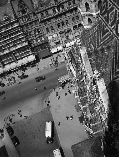 View taken from the top of St. Stephen's Cathedral (Stephansdom), Vienna, Austria, showing traffic and the bustling streets below. Date: 1930s