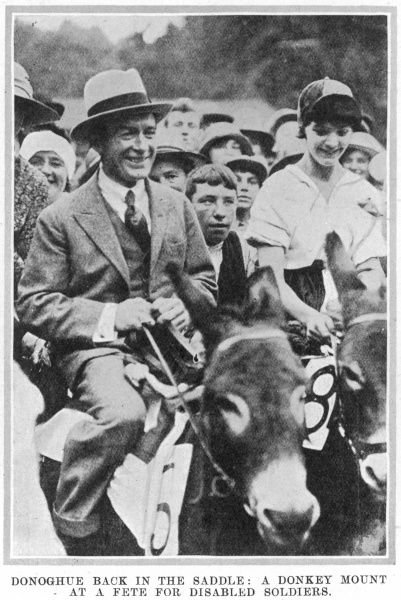 Steve Donoghue (1884 - 1945), English flat race jockey, winner of the Epsom Derby on six occasions pictured riding a donkey at a fete for disabled soldiers at Gifford House, Roehampton