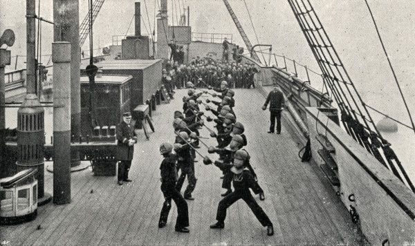 Boys in protective masks, taking part in stick practice on the Training Ship Wellesley, on the River Tyne at North Shields, Northumberland. In 1868, James Hall and other local businessmen set up a charity to provide shelter for Tyneside waifs