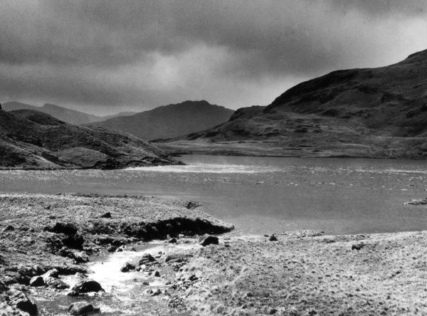 A whirlwind whips the surface of Stickle Tarn into a white foam. One of the beauty spots of the Lake District, Cumbria, England. Date: 1930s