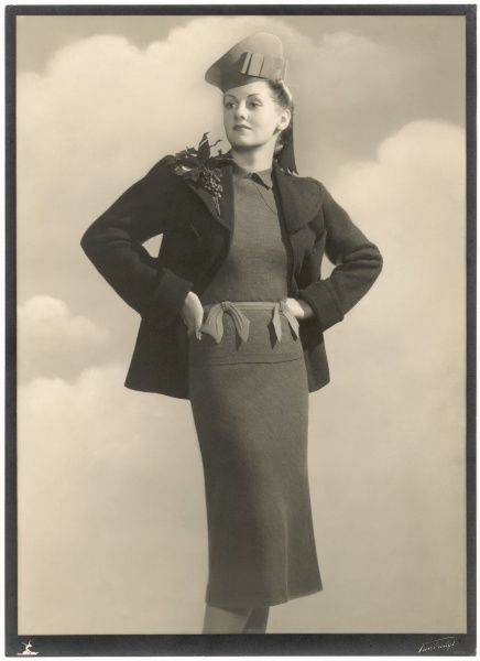 Outfit designed by Victor Stiebel (1907-1976) comprising of a wool sweater and skirt, jacket with large lapels and typical 1930s hat