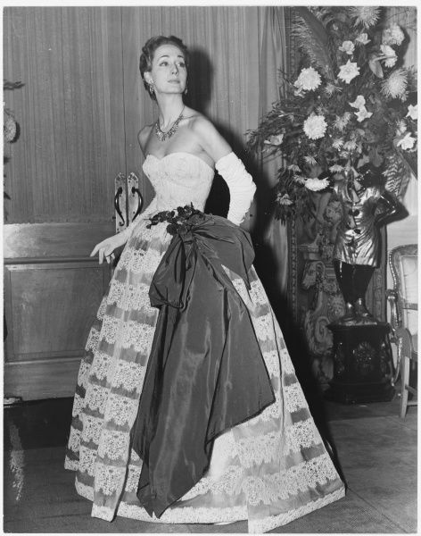 A sumptuous gown designed by Victor Stiebel modelled at a show at Claridge Hotel in London, in the presence of HM The Queen in 1952