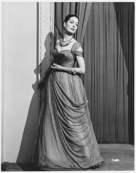 Actress Valerie Hobson (1917- 1998, aka Mrs John Profumo, dressed in a dress by Victor Stiebel for a Royal Command Performance in 1952
