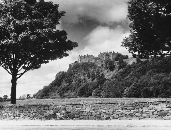 Set on a volcanic rock, commanding views for miles around, Stirling Castle was one of the most important strongholds in medieval Scotland. Date: 1930s
