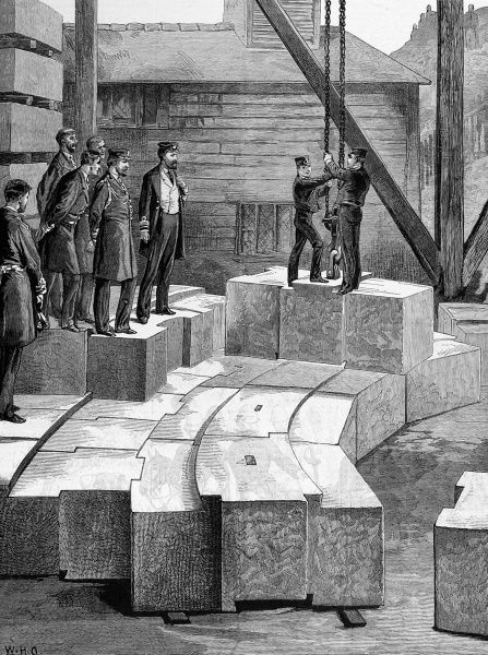 Engraving of the Prince of Wales visiting the Oreston granite quarry, viewing part of the masonry for the new Eddystone Lighthouse, August 1879. The interlocking design of the lighthouse walls, by Sir James Douglass, can be clearly seen