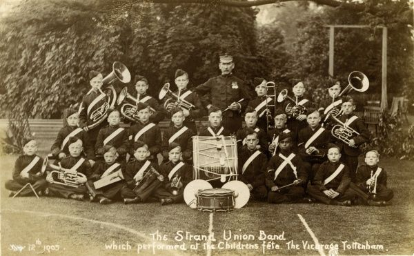 A group picture of the Strand Union Boys' Band on 12 July 1905, at the Children's Fete held at the Vicarage, Tottenham, North London