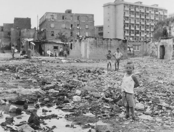 Street Children - Naples, Italy. The 'Scunizzi' street urchins, running wild amid the bombed buildings of Naples