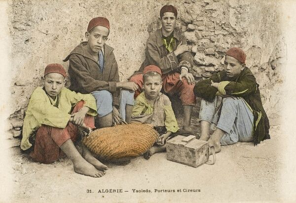 Young street hawkers and porters - Algeria. Date: circa 1910s