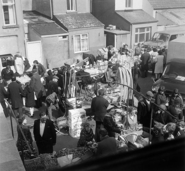 Aerial view of a busy street market in Brynmawr, Wales. Date: 1974