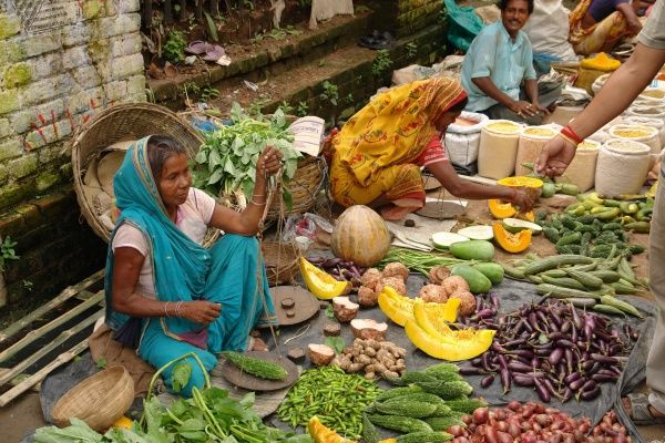 A street market selling fruit and vegetables at Matiari, a village in West Bengal, India
