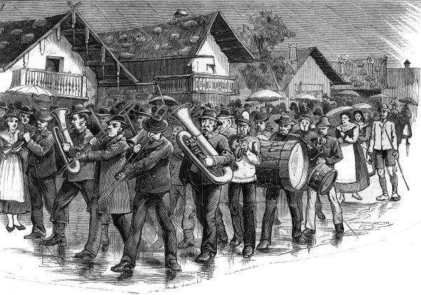 A marching band braves the rain at Oberammergau, Germany. Date: 1880