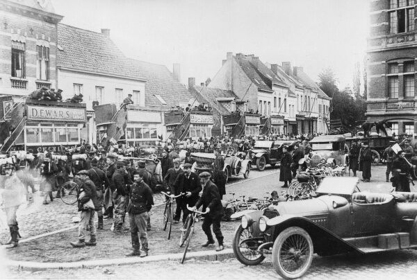 Street scene in Oude-God, near Antwerp, northern Belgium, during the First World War. Showing five British omnibuses containing British sailors and Belgian soldiers. Date: October 1914