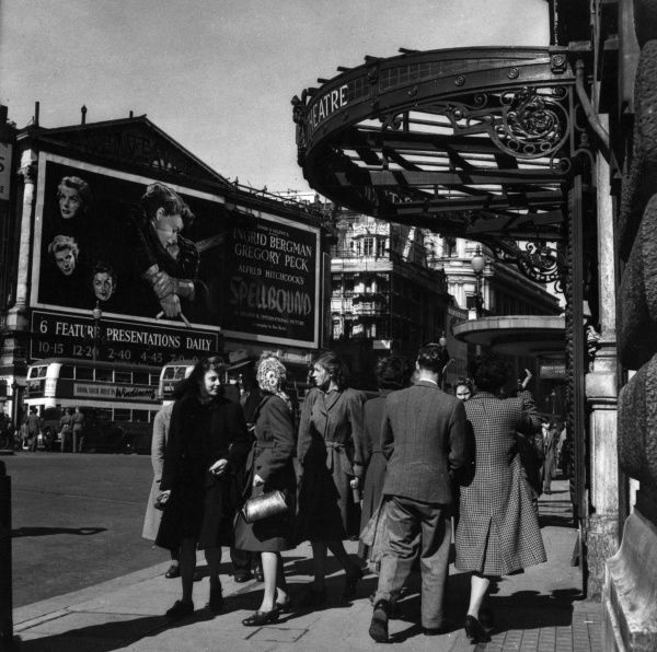 Street scene outside a Central London theatre. Across the road the film Spellbound (1945) is on show, starring Ingrid Bergman and Gregory Peck