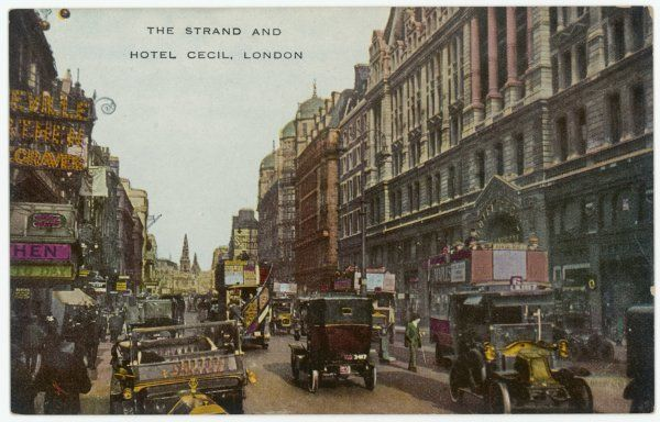 The Strand, London, looking east, with buses, cabs and cars - the car on the left sports an AA badge