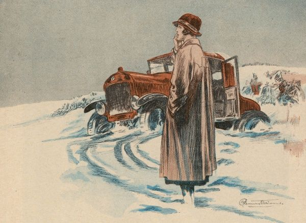 Lady motorist stuck in the snow