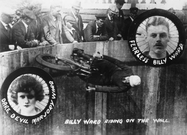 Wall of Death - Motorcycle rider 'Fearless Billy Ward' riding the wall (picture also shows 'Dare Devil Marjory Ward')