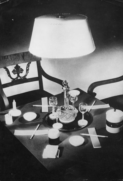 An idea for setting out your table ready for your bridge or card party. The candle may be left lit for the use of smokers. Date: 1930s