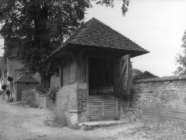 The Well House, built in the churchyard wall at Stoke-by- Nayland, Suffolk, England. Date: 1930s