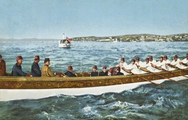 Sultan Mehmed V Reshad of Turkey (1844 - 1918) with his sons in an imperial barge returning to the Old Palace, with the more modern barge standing off in distance (see below)