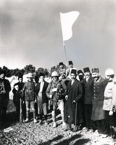 The surrender of Jerusalem to the British, on the Lifta-Jerusalem Road, during the First World War. The Mayor of Jerusalem, Hussein Salim Al-Husseini, stands at the centre (with walking stick). To his immediate right is Sergeant Frederick Hurcomb