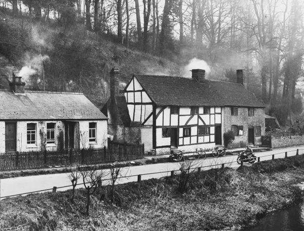 Picturesque black and white cottages and the fragrant smell of woodsmoke complete this beautiful corner of rural England, Eashing, a tiny hamlet near Godalming, Surrey