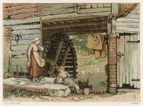 Two girls beside a water mill in Surrey, England