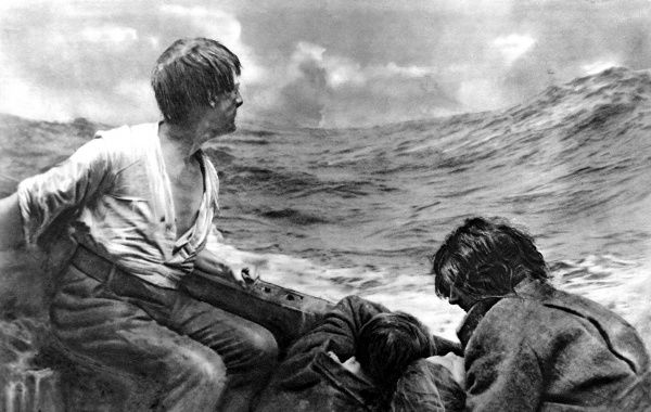 Photograph showing the survivors of a passenger ship, sunk by German submarine action, adrift at sea in a small lifeboat during the First World War