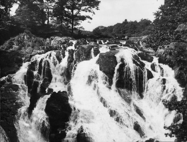 The beautiful Swallow Falls, north Wales, where the River Llugwy, after joining the Conway, hurls itself into a chasm sixty feet wide, in three falls. Date: 1940s