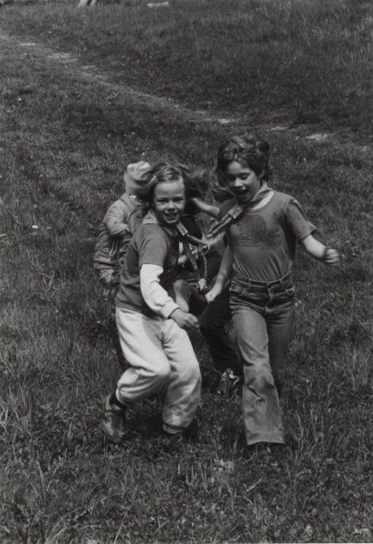 A group of three Swedish Beaver Scouts playing and running.  circa 1980s