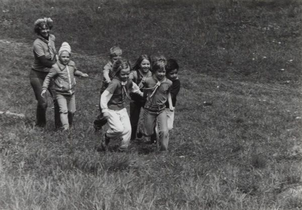 A group of Swedish Beaver Scouts and leader playing a game together