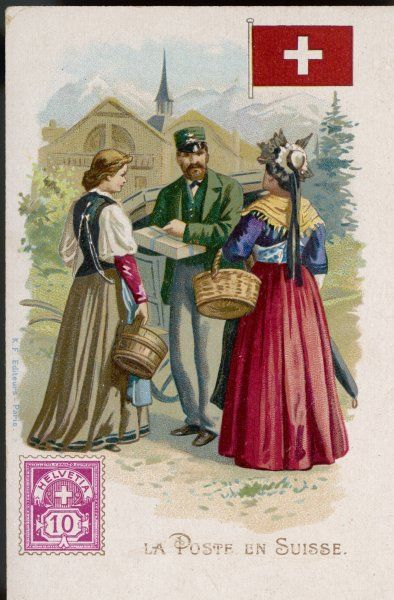 In an Alpine village, the postman hands a parcel to two women in regional costume