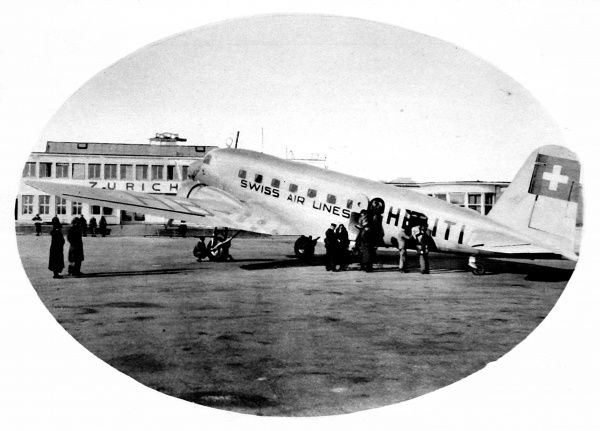 Photograph of a Swissair aeroplane, of a type used between London and Zurich in 1936, seen at Zurich Airport