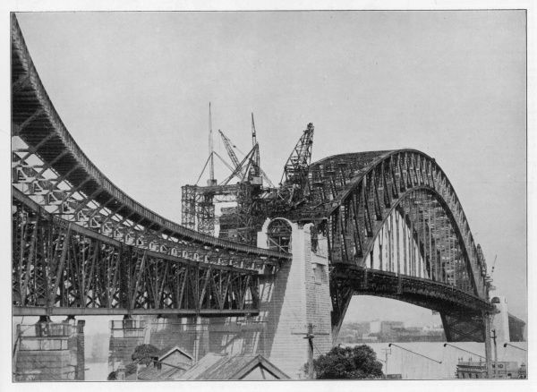 The Sydnet Harbour bridge nearing completion : at the time of its opening, it is the largest suspension bridge in the world