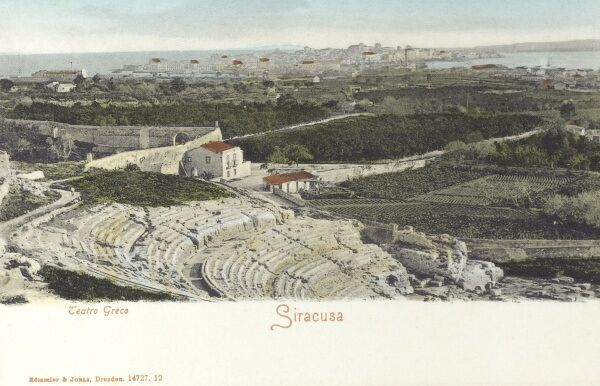 Syracuse, Italy (Siracusa) - The Greek Theatre with the cty in the distance. The cavea (seating area) is one of the largest ever built by the ancient Greeks: it has 67 rows, divided into nine sections with eight aisles. Only traces of the scene