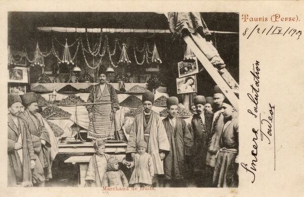 A Beautiful early photographic picture postcard showing a Fruit Seller