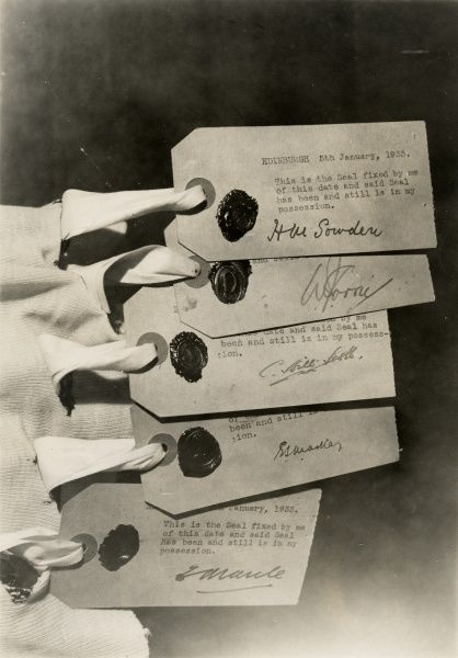 Photograph of the five tags attached to the undervest, signed by witnesses at the Edinburgh exposure of the Scottish medium Helen Duncan, 11 May 1933