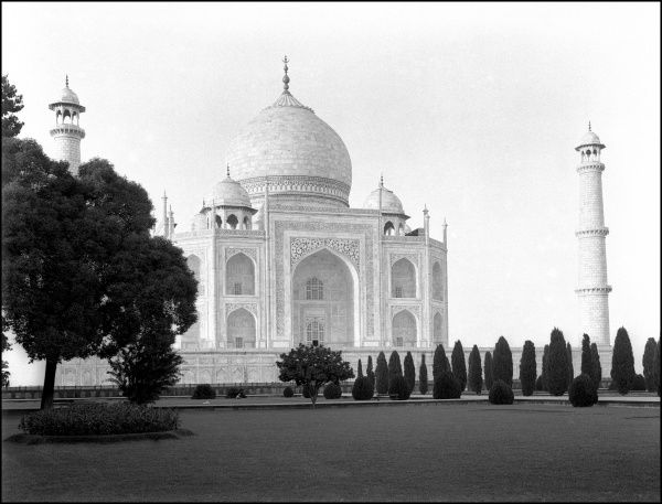 The Taj Mahal, Agra, India. A mausoleum built by Mughal Emperor Shah Jahan in memory of his favorite wife, Mumtaz Mahal. Considered the finest example of Mughal architecture. Photograph by Ralph Ponsonby Watts