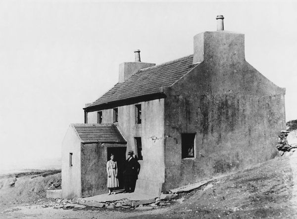 "The home of Voirrey Irving at Cashen's Gap, Isle of Man, where Gef, the ""Talking Mongoose"" manifested : Voirrey stands with her father at the front door"