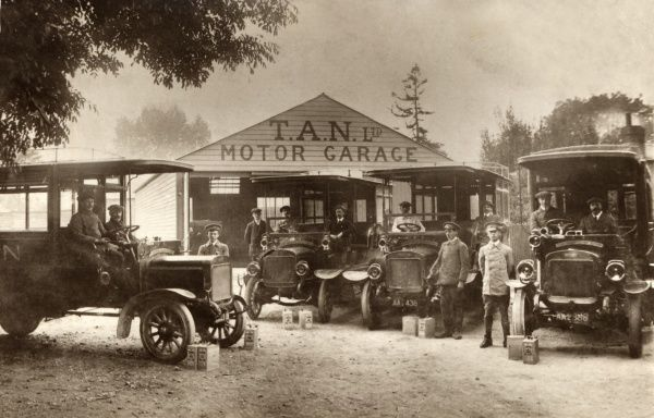 Four Model T Ford cars in the forecourt of the T.A.N. Motor Garage