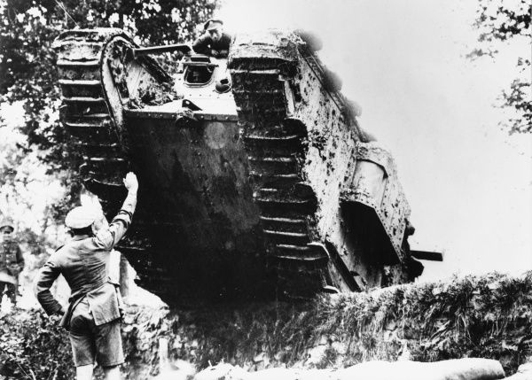 A British soldier stops a tank in Costhoek Wood, Belgium on the Western Front during World War I in September 1917