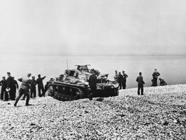 Tank positioned by the coast at Dunkirk during World War II