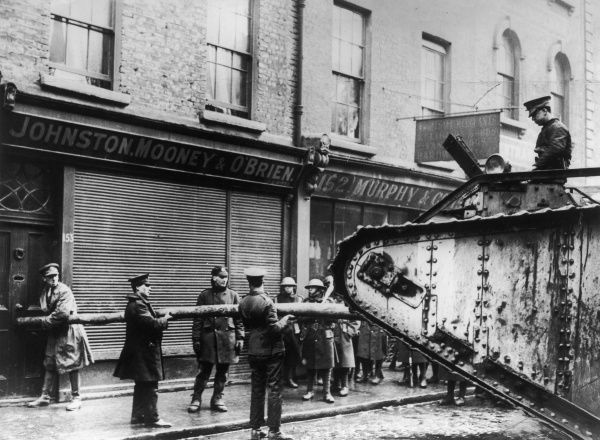 O.P.S troops using a tank as a battering ram to force entry into a barricaded building during the Easter Rising in Dublin of 1916