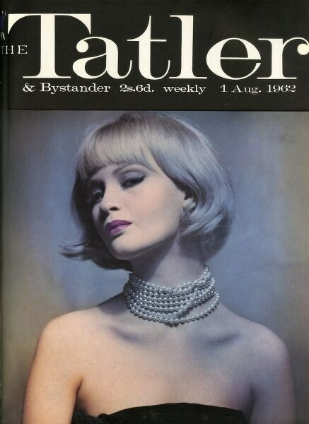 A model wearing typical sixties make up and with a smart, blonde bob strikes an arrogant pose on the front cover of The Tatler while wearing a choker of pearls