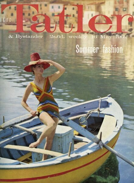 Front cover of The Tatler's summer fashion issue for 1962 featuring a photograph of a girl wearing a jazzy swimsuit standing in a boat at Cala Piccola in Italy. A high-crowned red straw sun hat completes the look. Date: 1962